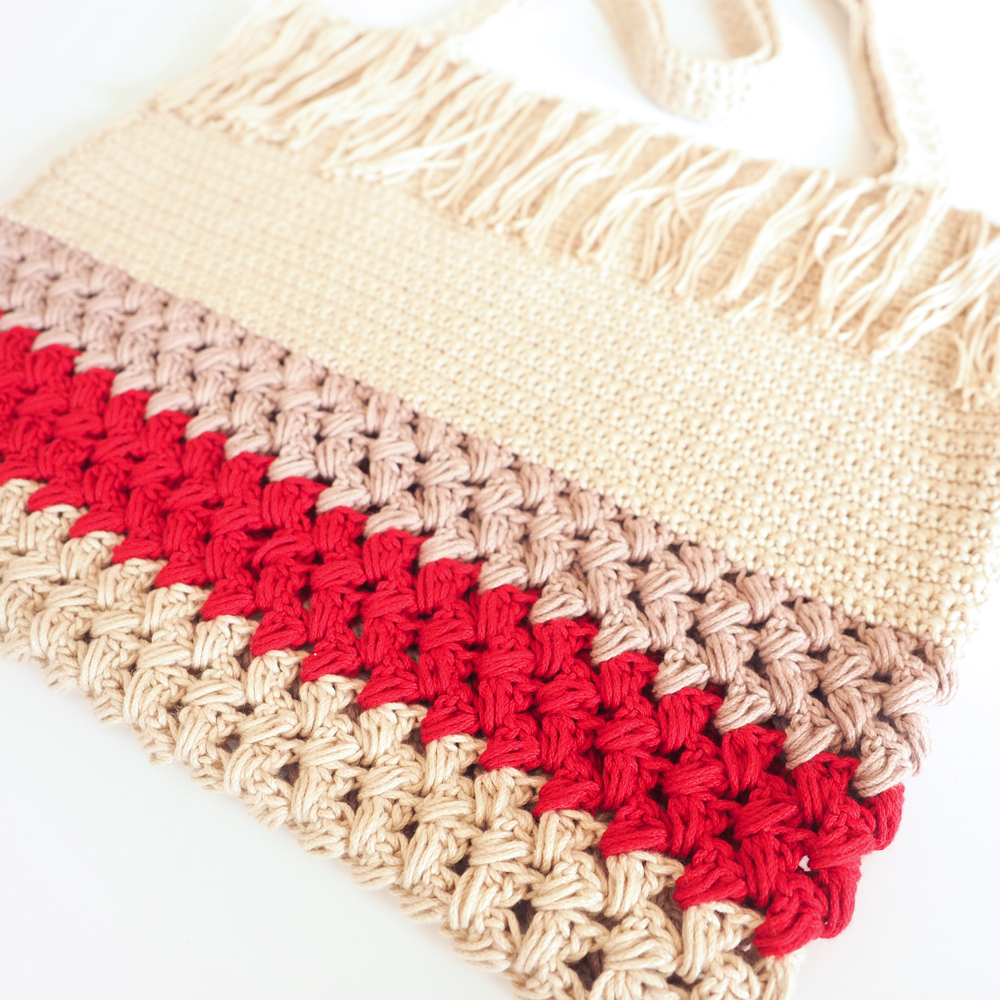 The Fringe Shopping Bag is roomy enough to hold all of your groceries or your entire wardrobe. #crochetbag #crochettote #crochetpattern #crochetlove #crochetaddict