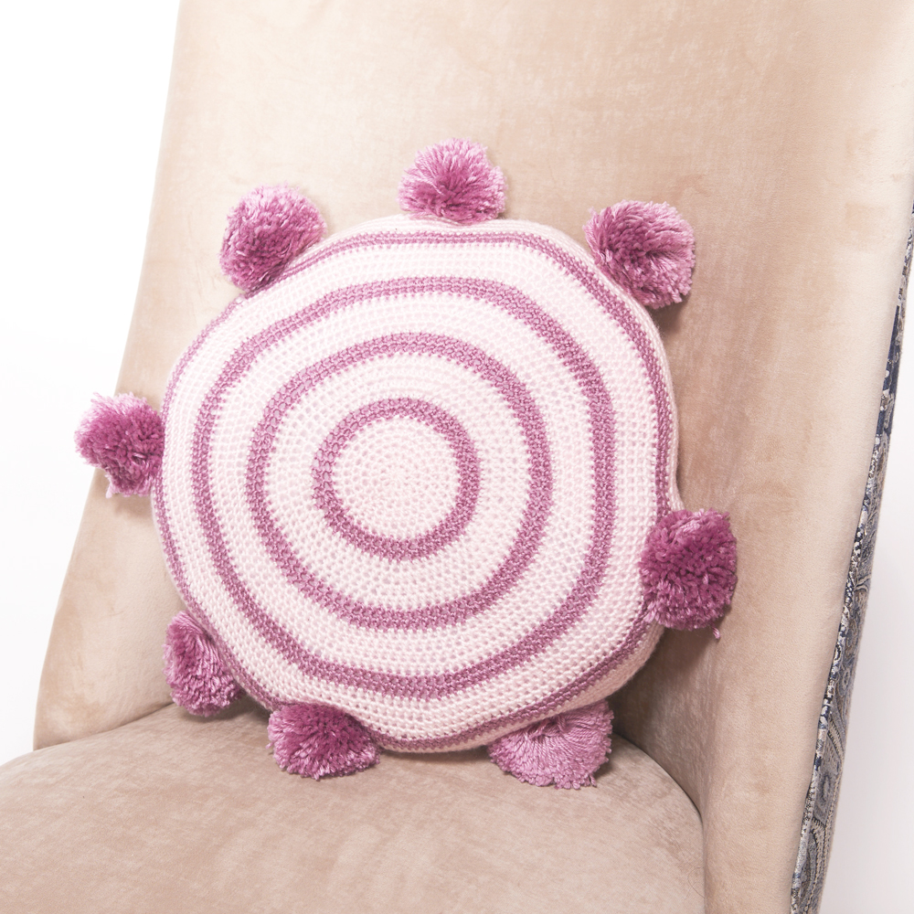 This Pom Pom Cushion makes an absolutely wonderful housewarming gift or statement piece for your home. #crochetcushion #crochetpillow #crochetpattern #crochetlove #crochetaddict