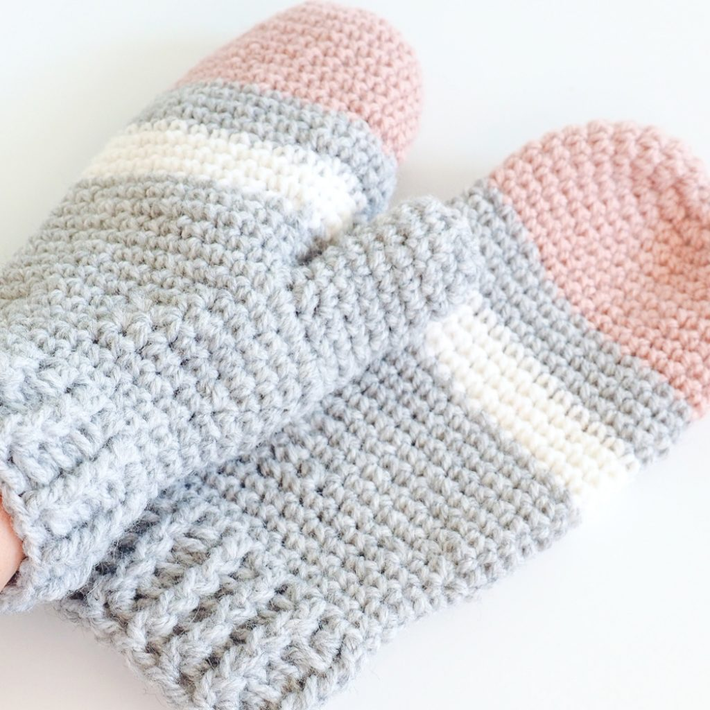 These striped crochet mittens are perfect for a day spent in a winter wonderland. This free crochet pattern will keep you warm and cozy. #CrochetMittens #CrochetPattern #CrochetGloves #CrochetAddict