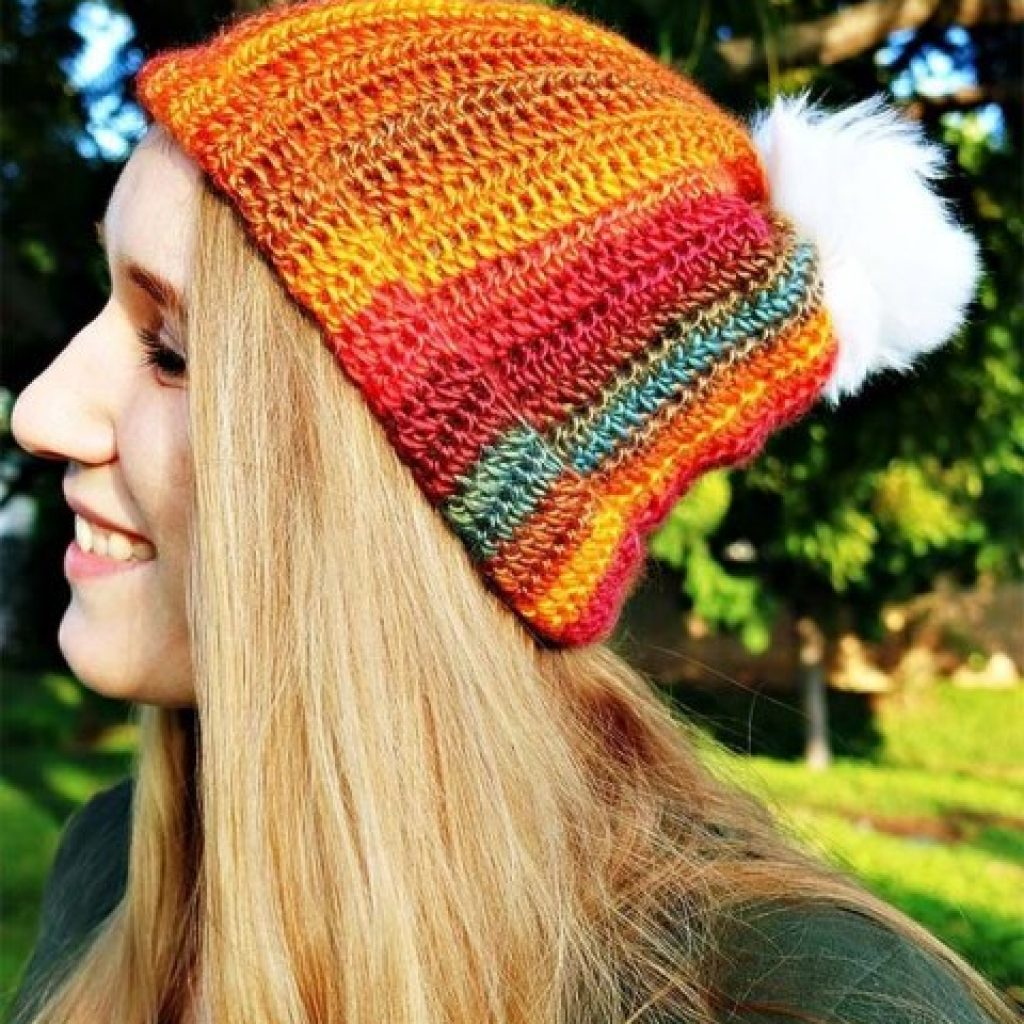 Sunset Striped Hat - If you're looking for a crochet hat pattern that suits your needs and looks great on everyone, the crochet slouchy hat is perfect for you. #crochethatpattern #crochetslouchyhat #crochetpattern #crochetslouchbeanie