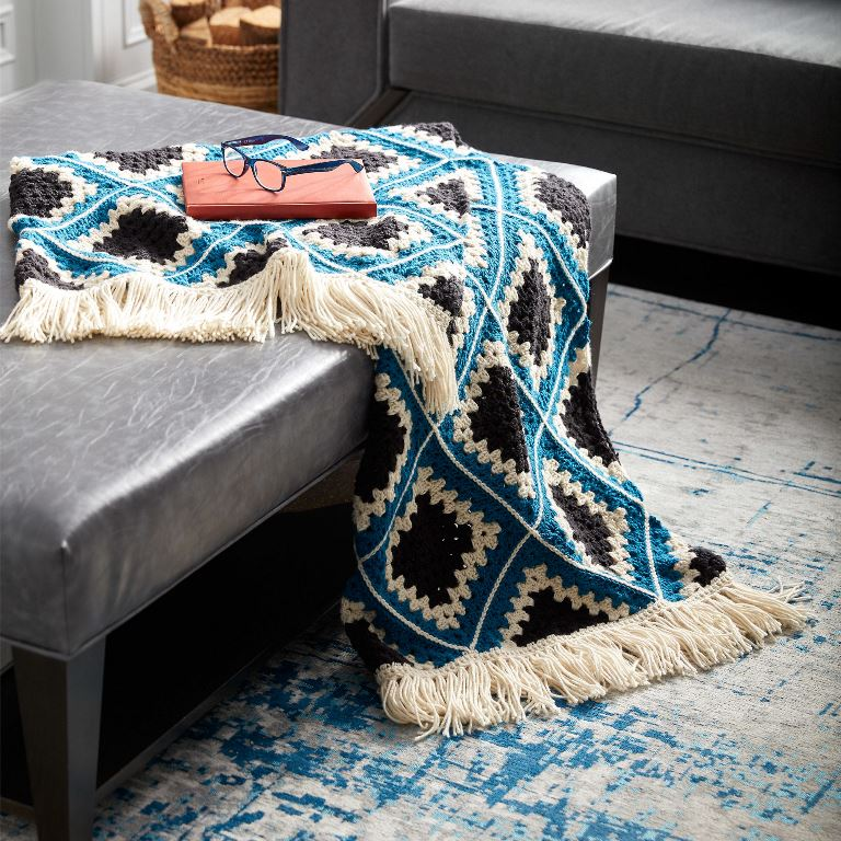 Caron Diamond Crochet Granny Afghan - This list has the best crochet afghan patterns out there. From chunky, thick fabrics, to delicate details, you can find whatever you're looking for. #CrochetAfghanPatterns #CrochetPatterns #AfghanPatterns #FreeCrochetPatterns