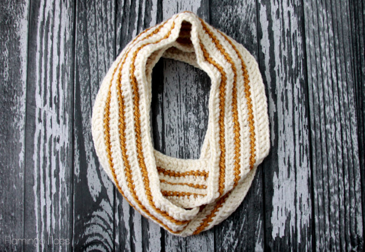 Cozy Striped Infinity Scarf - If you're just learning how to crochet, a crochet infinity scarf will be your best friend. Take advantage of this and make one for the people you love. #CrochetInfinityScarf #ScarfCrochetPatterns #CrochetPatterns