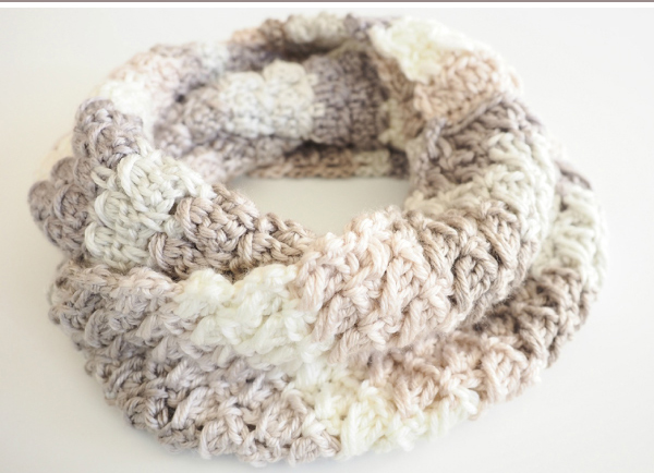 Cross-Over Stitch Infinity Scarf - If you're just learning how to crochet, a crochet infinity scarf will be your best friend. Take advantage of this and make one for the people you love. #CrochetInfinityScarf #ScarfCrochetPatterns #CrochetPatterns