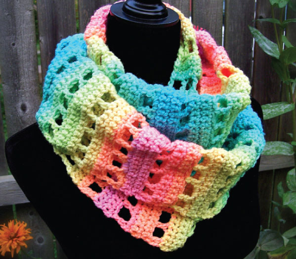 Jumping Retro Infinity Scarf - If you're just learning how to crochet, a crochet infinity scarf will be your best friend. Take advantage of this and make one for the people you love. #CrochetInfinityScarf #ScarfCrochetPatterns #CrochetPatterns