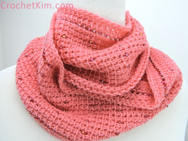 Pink Fantasy Infinity Scarf - If you're just learning how to crochet, a crochet infinity scarf will be your best friend. Take advantage of this and make one for the people you love. #CrochetInfinityScarf #ScarfCrochetPatterns #CrochetPatterns