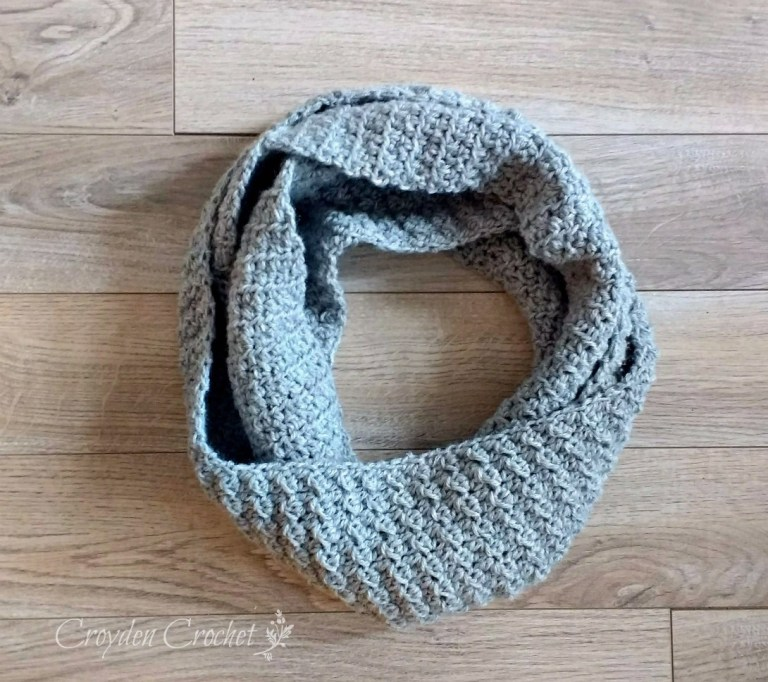 The Cambridge Infinity Scarf - If you're just learning how to crochet, a crochet infinity scarf will be your best friend. Take advantage of this and make one for the people you love. #CrochetInfinityScarf #ScarfCrochetPatterns #CrochetPatterns