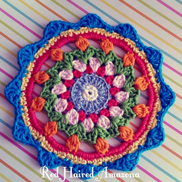 Happy Flower Mandala - There's nothing quite like a crochet mandala. These all free crochet patterns are fun and useful for many different purposes. #CrochetMandala #FreeCrochetPattern #CrochetMandalaPattern