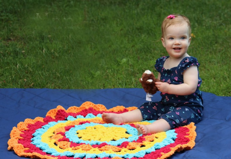 Mandala Toddler Mat - There's nothing quite like a crochet mandala. These all free crochet patterns are fun and useful for many different purposes. #CrochetMandala #FreeCrochetPattern #CrochetMandalaPattern