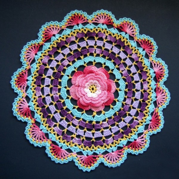 Radiant Rose Mandala Doily - There's nothing quite like a crochet mandala. These all free crochet patterns are fun and useful for many different purposes. #CrochetMandala #FreeCrochetPattern #CrochetMandalaPattern