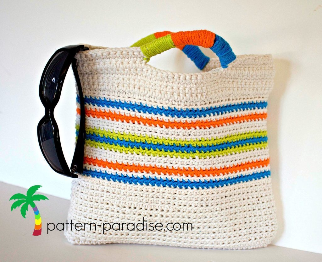Tutti Fruitti Clutch - Are you ready for the best crochet bag patterns out there? This list has 18 fun summer bags and they're all free crochet patterns! #CrochetBagPatterns #EasyBagPatterns #FreeCrochetPatterns