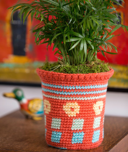 Tapestry Flower Pot Cozy - Tapestry crochet patterns are really unique. Try your hand at making these and see if you don't fall in love with the crochet tapestry. #TapestryCrochetPatterns #CrochetPatterns #FreeCrochetPatterns