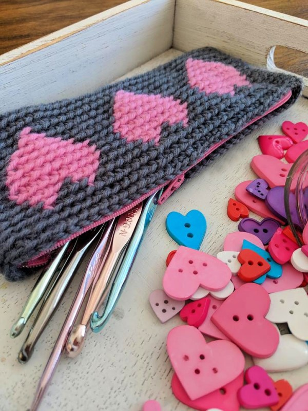 Tapestry Heart Pencil Case - Tapestry crochet patterns are really unique. Try your hand at making these and see if you don't fall in love with the crochet tapestry. #TapestryCrochetPatterns #CrochetPatterns #FreeCrochetPatterns