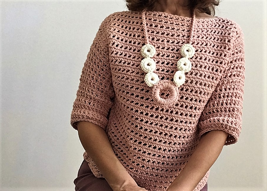 Crazy Cool Blushing Autumn Sweater - These 16 super easy crochet sweater patterns are the best we've found. There's a good variety to choose from whether you like them light, cropped or with a classic look. #easycrochetsweaterpatters #easycrochetpatterns #crochetsweaters