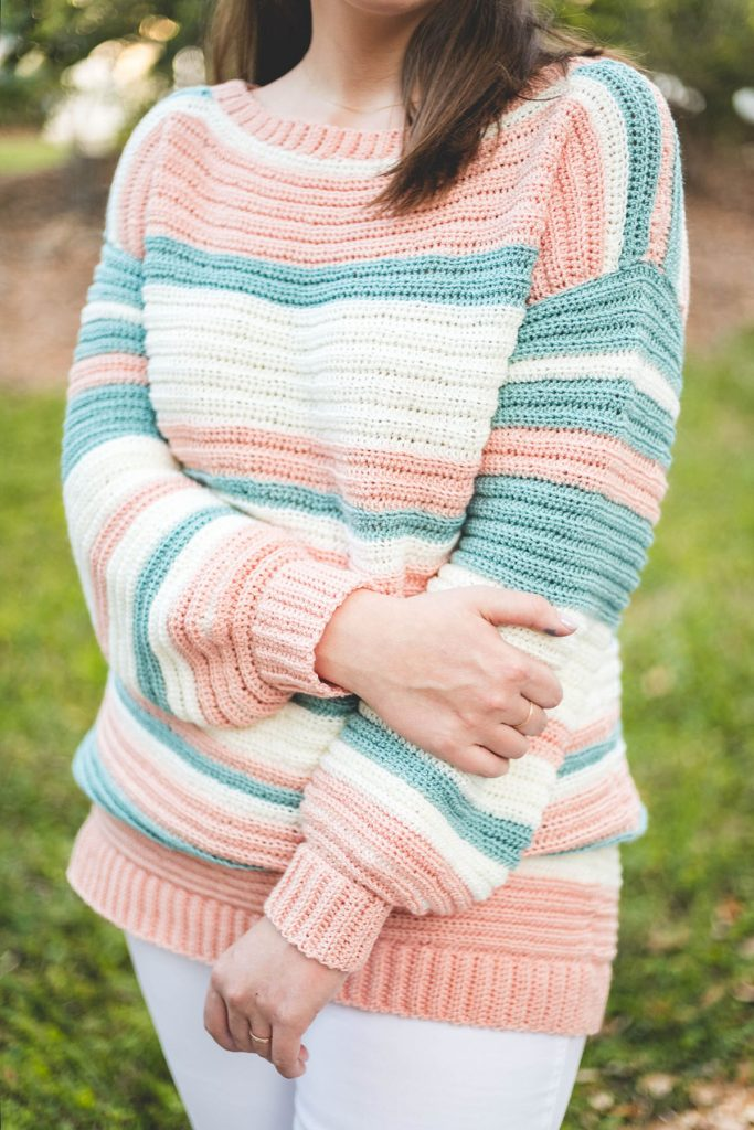 Crochet Magic Stripe Sweater - These 16 super easy crochet sweater patterns are the best we've found. There's a good variety to choose from whether you like them light, cropped or with a classic look. #easycrochetsweaterpatters #easycrochetpatterns #crochetsweaters