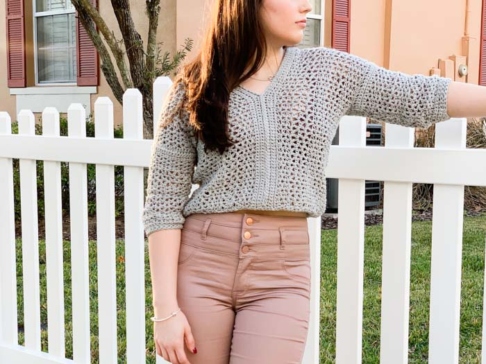 Lightweight Cropped Crochet Sweater - These 16 super easy crochet sweater patterns are the best we've found. There's a good variety to choose from whether you like them light, cropped or with a classic look. #easycrochetsweaterpatters #easycrochetpatterns #crochetsweaters