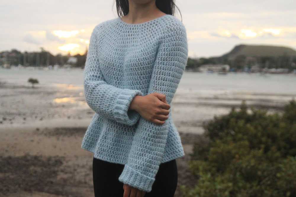 Julia Peplum Crochet Sweater - These 16 super easy crochet sweater patterns are the best we've found. There's a good variety to choose from whether you like them light, cropped or with a classic look. #easycrochetsweaterpatters #easycrochetpatterns #crochetsweaters