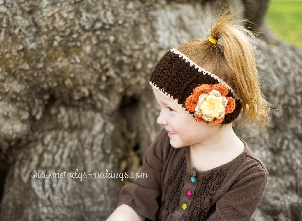 Falling Flowers Ear Warmer - Check out these cute, versatile and functional crochet ear warmer patterns and get started on your stock before the cold sets in! #crochetearwarmerpatterns #crochetearwarmers #crochetpatterns