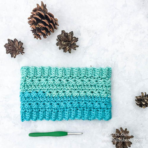 Snow Drops Ear Warmer - Check out these cute, versatile and functional crochet ear warmer patterns and get started on your stock before the cold sets in! #crochetearwarmerpatterns #crochetearwarmers #crochetpatterns