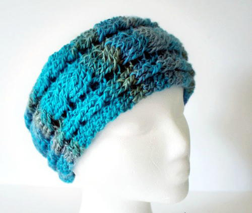 Unforgettable Cables Ear Warmer - Check out these cute, versatile and functional crochet ear warmer patterns and get started on your stock before the cold sets in! #crochetearwarmerpatterns #crochetearwarmers #crochetpatterns