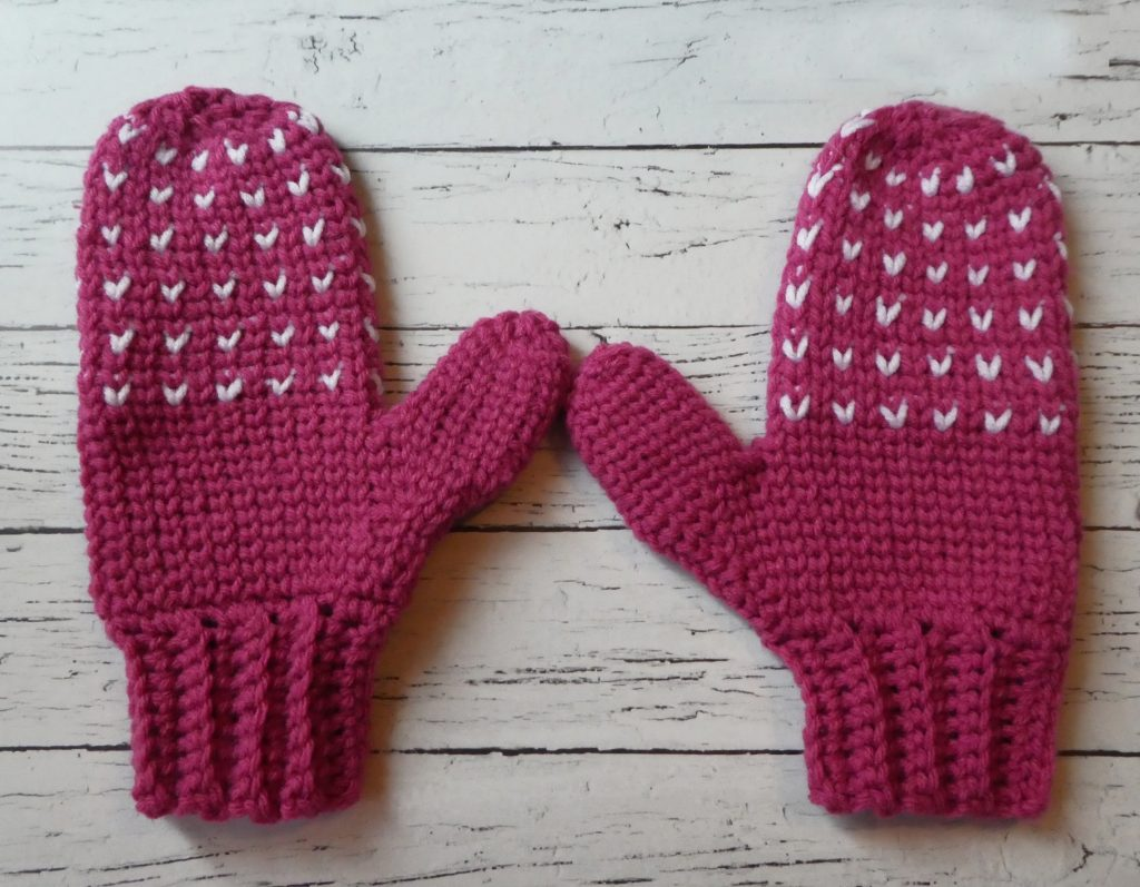 Snow Day Crochet Mittens - These crochet mitten patterns will warm your hands up and keep them ready for use throughout the season. #crochetmittenpatterns #crochetpatterns #freecrochetpatterns