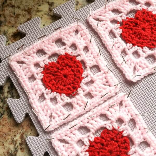 Heartful Granny Square - If you're thinking of starting a crochet blanket and want to give it that extra touch of 'oomph' - using any of these crochet squares might be the thing you need! #crochetsquares #afghansquares #crochetpatterns