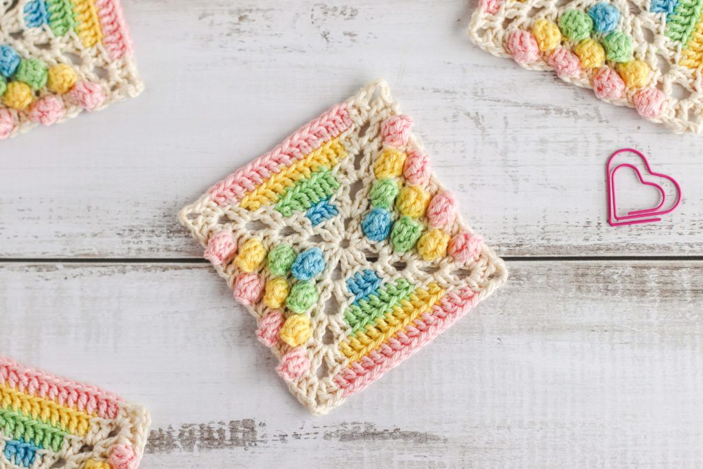 Rainbow Gumdrop Crochet Square - If you're thinking of starting a crochet blanket and want to give it that extra touch of 'oomph' - using any of these crochet squares might be the thing you need! #crochetsquares #afghansquares #crochetpatterns